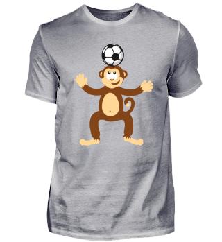 Kindermotiv Affe spielt Fußball