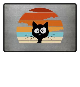 schwarze Katze vor Retro Sonnenuntergang